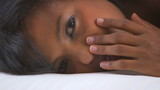 Close up of black girl covering face with hands