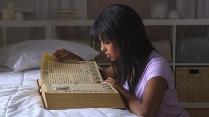 Black girl studying bible