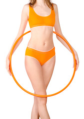 Young woman exercising with hula hoop