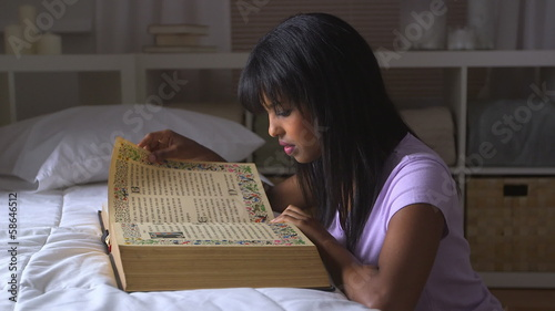 African American girl reading bible