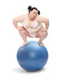 Obese woman balancing on a blue ball.
