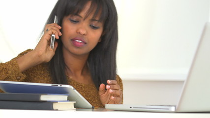 African American college student talking on cell phone while stu