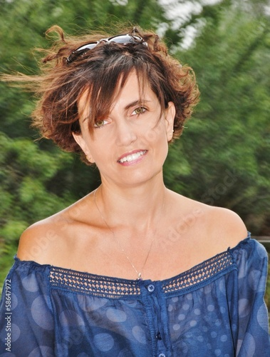 portrait of a beautiful woman of forty, with bare shoulders