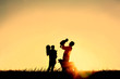 Leinwanddruck Bild - Silhouette of Happy Family and Dog