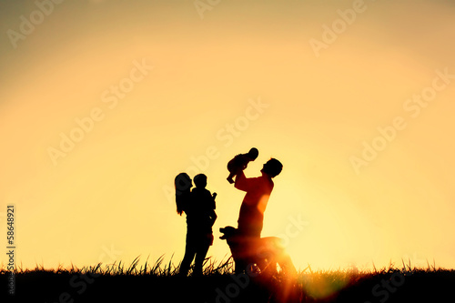 Silhouette of Happy Family and Dog - 58648921