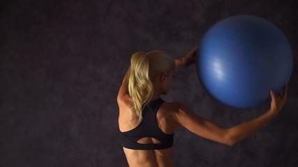 Woman lifting an exercise ball