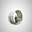 businessman  walking in money wheel