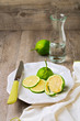Lemon on plate on wooden table