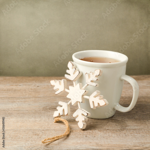 Cup of tea with Christmas decoration snowflake