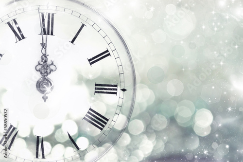 Old clock with stars and snowflakes