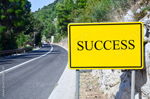 success in street sign on motorway