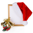 Christmas hat hung on old frame isolated on white