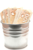 Hundred Canadian dollar bills in an aluminium  pot