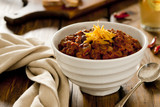 Chunky beef chili topped with cheddar cheese.