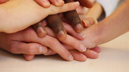 Teenager stacking hands for teamwork