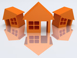 Three orange houses with reflection. 3d render.