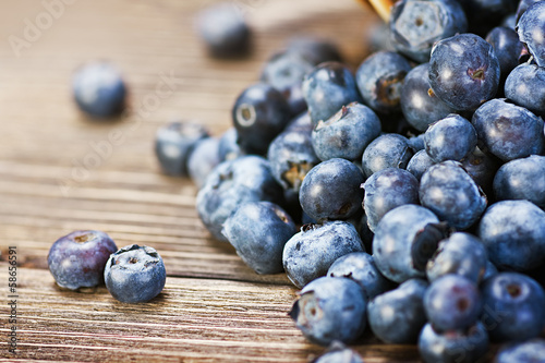 Fresh blueberries scattered on the wooden table