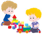 Fototapety Little boys playing with a toy truck and bricks