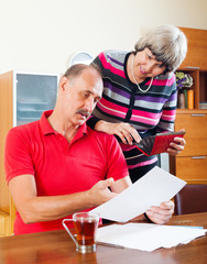 senior family  with financial documents