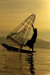 Fisherman of Inle Lake in action how to fishing, Myanmar, silhou