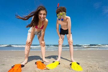 Teenage girl and boy on beach