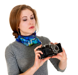young girl is looking vintage camera