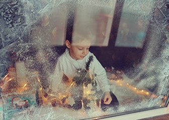 boy in winter window