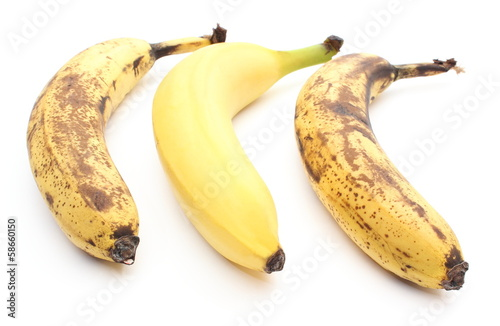Fresh and overripe bananas on white background