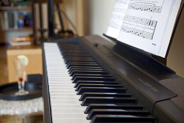 Rome, electronic piano keyboard with music score