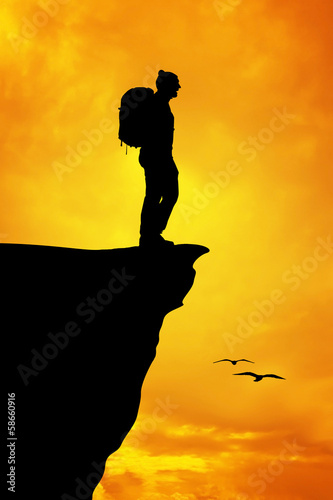 Silhouette of a man on a mountain top