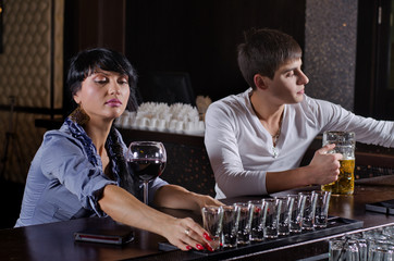 Woman alcoholic lining up a row of drinks