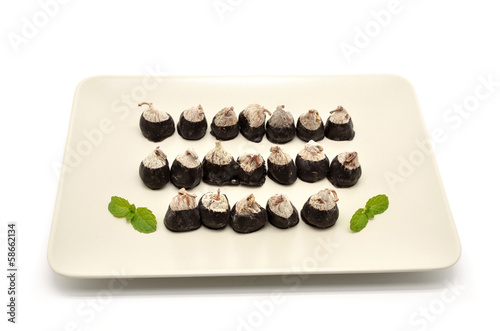 dried figs with almonds topped with chocolate