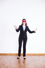 Blindfold businesswoman