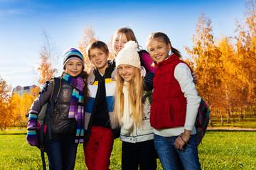 Happy teen friends outside