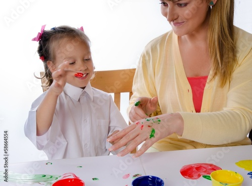 mother and daughter paint with finger