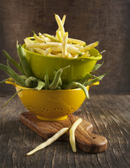Fresh Green and Yellow Beans on wooden table