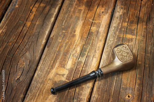 vintage tobacco pipe on wooden table