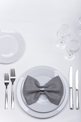 Celebration table set with bow napkin