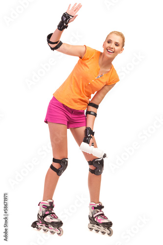Woman on rollerblades waving hand.