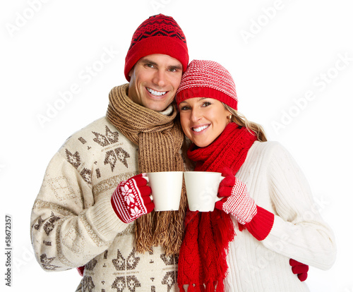 Christmas couple drinking hot tea.