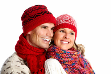 Happy smiling couple in winter clothing.