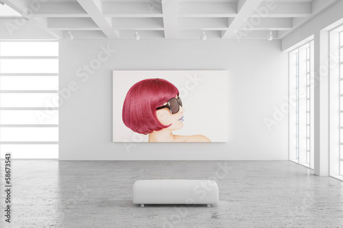 canvas print picture Empty exhibition hall with picture of a woman