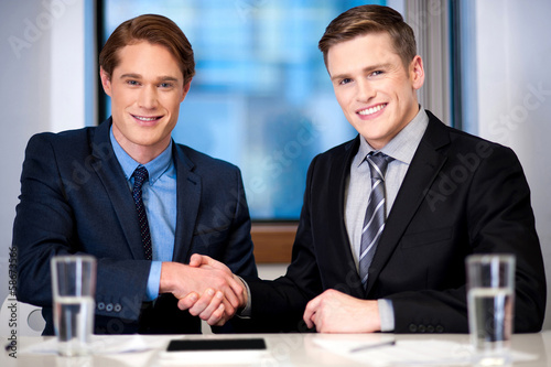 Corporate guys shaking hands