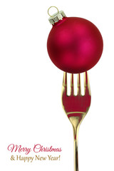 Golden fork with Christmas ball isolated on white background