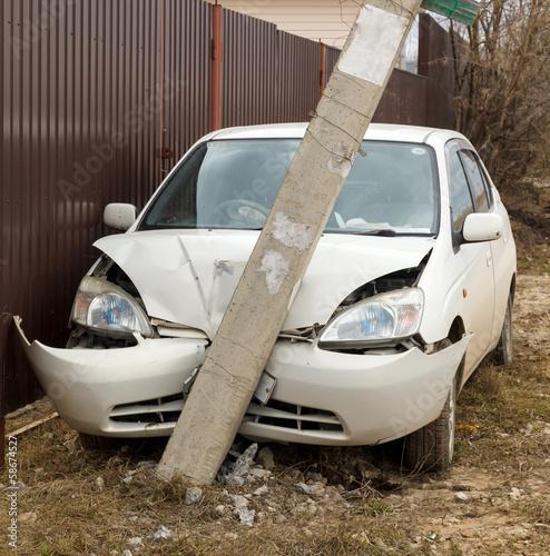 Leinwandbild Motiv car crashed into a pole