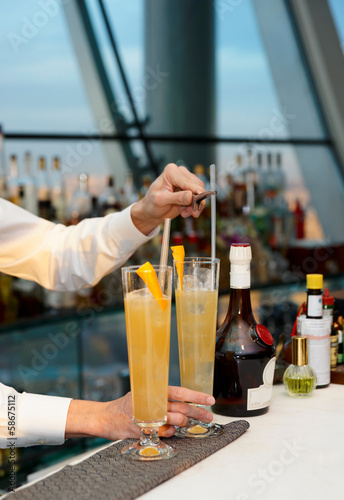 Bartender is stirring a cocktail
