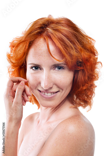 Beautiful girl with red hair and freckles