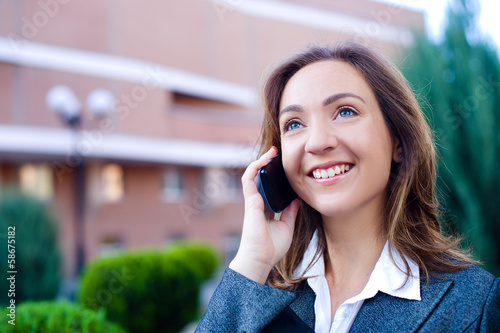 Business woman talking cell phone