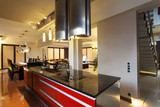 Black and red counter in kitchen