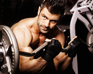 guy in a gym with dumbbell